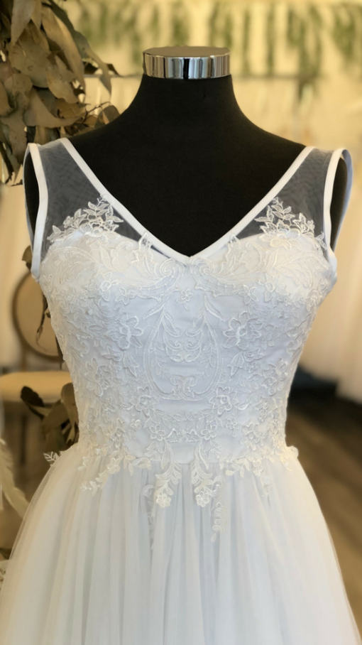 Front of a beautiful lace wedding gown in Boronia